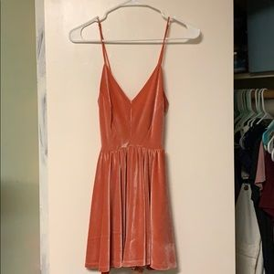 A salmon velvet romper from urban outfitters